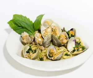 Linguine and clams in a white wine sauce.